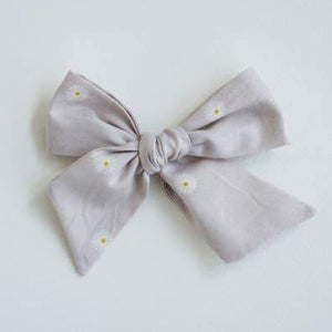 wanderlust and daisy chain bow