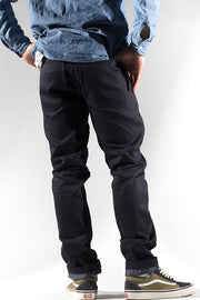 back view of utility zero cotton jeans in indigo finish by redew