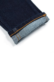 rolled cuff on a pair of bjork jeans by redew in indigo implode finish