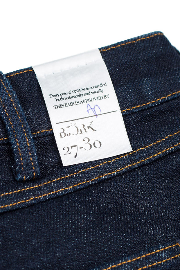 size detail on a pair of bjork jeans by redew in indigo implode finish