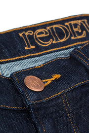 waistband and copper stud button on a pair of bjork jeans by redew in indigo pre-shrunk finish