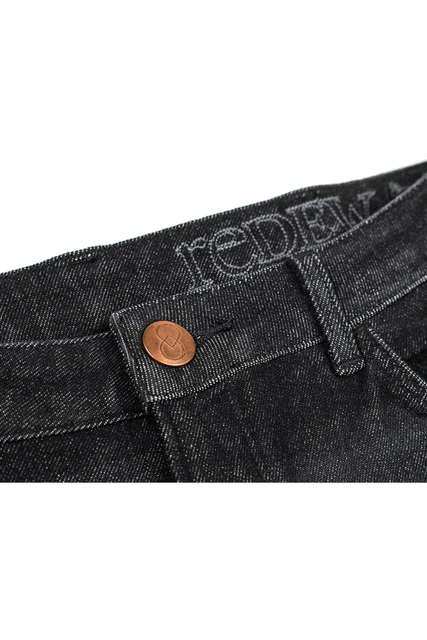 waistband and copper stud button on a pair of orn jeans by redew in black implode finish