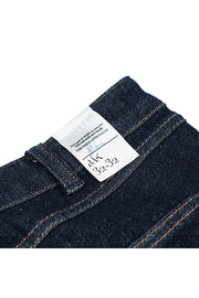 size detail on a pair of rak jeans by redew in indigo implode finish