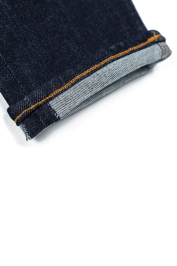rolled cuff on a pair of rak jeans by redew in indigo pre-shrunk finish