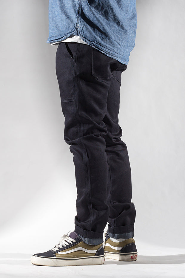 side view of utility zero cotton jeans in indigo finish by redew