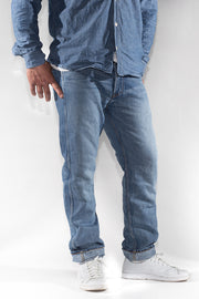 three quarter view of ravin zero cotton jeans in indigo 123 days finish by redew