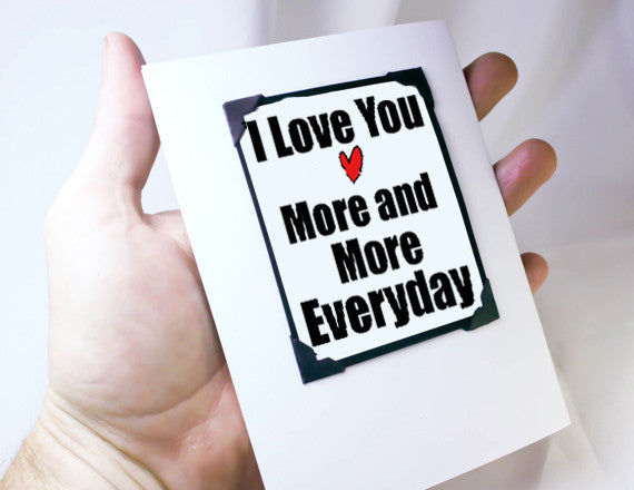 love you more and more anniversary card and gift