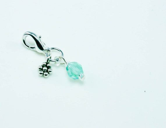 flower charm with blue birth stone