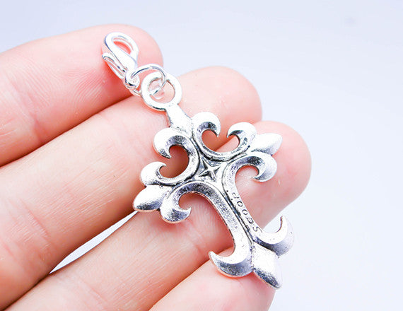 cross charm as necklace pendant