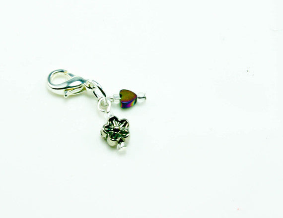 flower charm with red birthstone