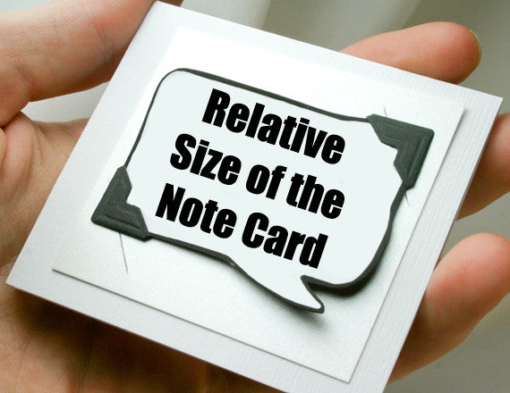 white note card and magnet