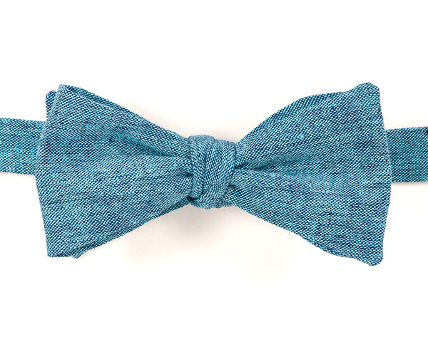 "Dyed Linen Turquoise Self Tie Bow Tie Classic Butterfly Shape Adjustable from 14.5""-18"" Handmade in Seattle, WA Didn't find the right color or size? Special event, party, school formal or wedding that needs a bespoke bow tie?   We'd love to custom make your perfect bow tie. Shoot us an email and we'll work with you to find the right fit."