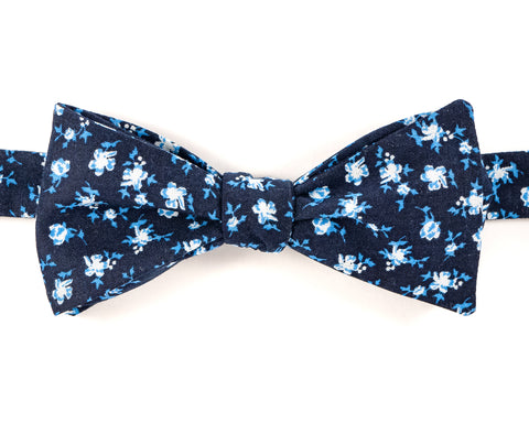 "100% Cotton Navy w/ Blue & White Print Self Tie Bow Tie Classic Butterfly Shape Adjustable from 14.5""-18"" Handmade in Seattle, WA Didn't find the right color or size? Special event, party, school formal or wedding that needs a bespoke bow tie?   We'd love to custom make your perfect bow tie. Shoot us an email and we'll work with you to find the right fit."