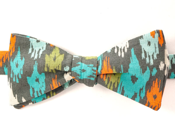 "100% Cotton Gray w/Multi Color Print Self Tie Bow Tie Classic Butterfly Shape Adjustable from 14.5""-18"" Handmade in Seattle, WA Didn't find the right color or size? Special event, party, school formal or wedding that needs a bespoke bow tie?   We'd love to custom make your perfect bow tie. Shoot us an email and we'll work with you to find the right fit."