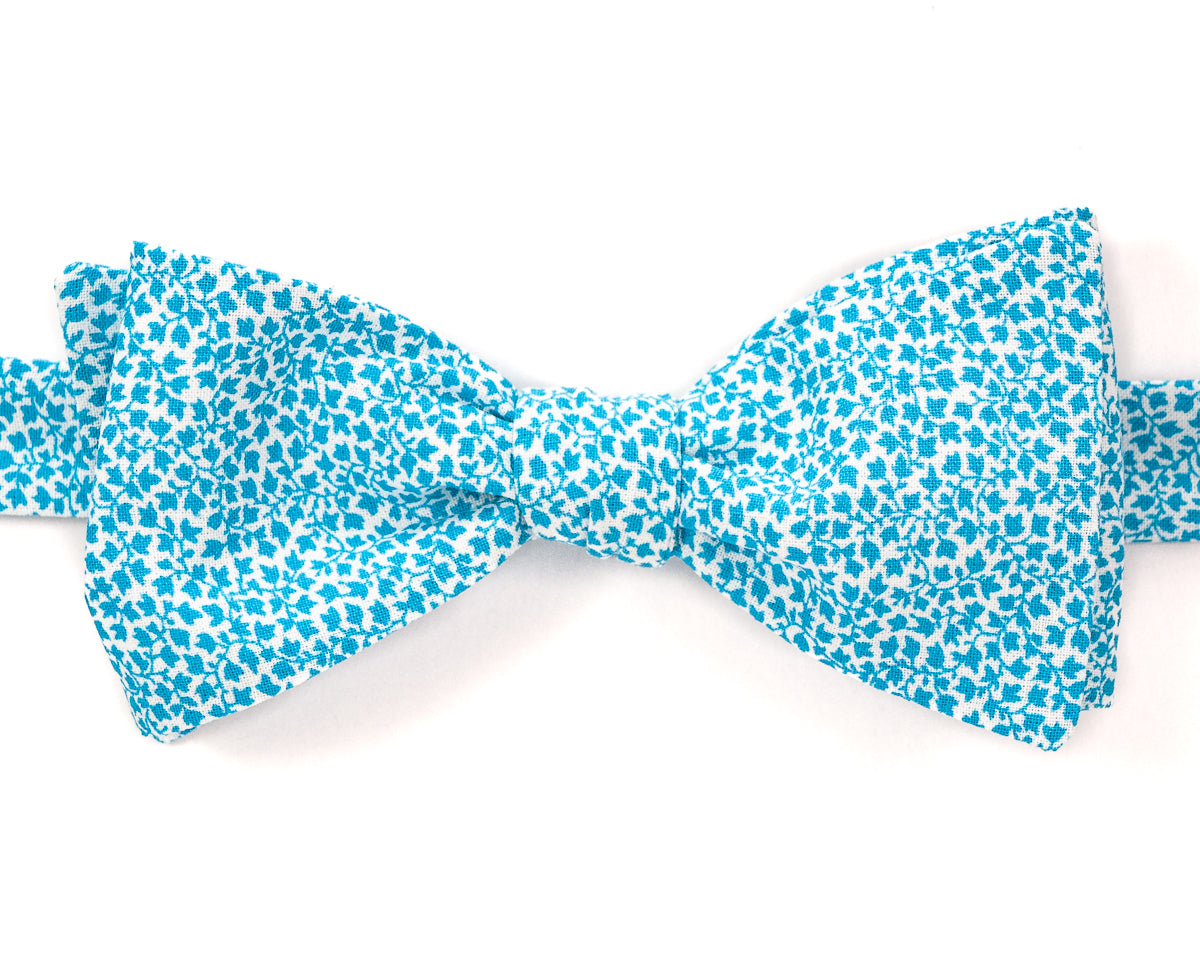 "100% Cotton White w/Teal Print Self Tie Bow Tie Classic Butterfly Shape Adjustable from 14.5""-18"" Handmade in Seattle, WA Didn't find the right color or size? Special event, party, school formal or wedding that needs a bespoke bow tie?   We'd love to custom make your perfect bow tie. Shoot us an email and we'll work with you to find the right fit."