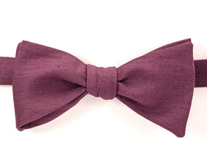 "100% Linen Plum Self Tie Bow Tie Classic Butterfly Shape Adjustable from 14.5""-18"" Handmade in Seattle, WA Didn't find the right color or size? Special event, party, school formal or wedding that needs a bespoke bow tie?   We'd love to custom make your perfect bow tie. Shoot us an email and we'll work with you to find the right fit."
