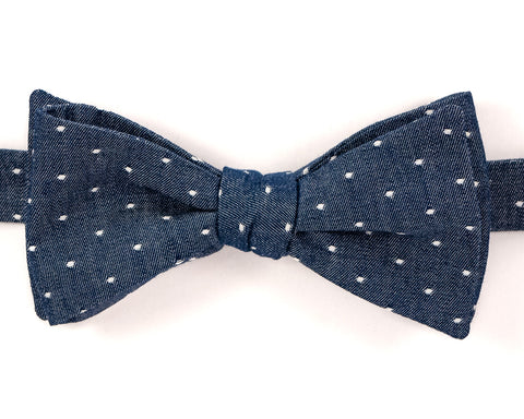 "100% Cotton Chambray Navy Blue w/ White Dots Self Tie Bow Tie Classic Butterfly Shape Adjustable from 14.5""-18"" Handmade in Seattle, WA    Didn't find the right color or size? Special event, party, school formal or wedding that needs a bespoke bow tie?   We'd love to custom make your perfect bow tie. Shoot us an email and we'll work with you to find the right fit."