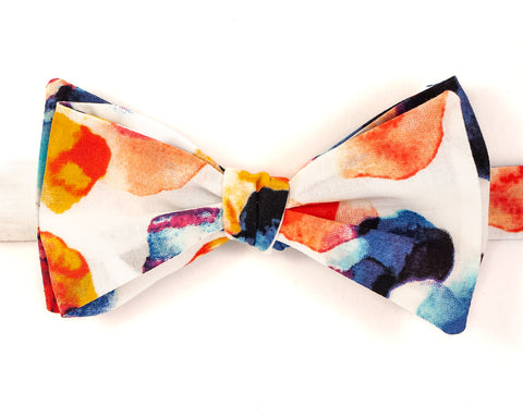 "100% Cotton Voile White w/ Multi Color Watercolor Print Self Tie Bow Tie Classic Butterfly Shape Adjustable from 14.5""-18"" Handmade in Seattle, WA Didn't find the right color or size? Special event, party, school formal or wedding that needs a bespoke bow tie?   We'd love to custom make your perfect bow tie. Shoot us an email and we'll work with you to find the right fit."