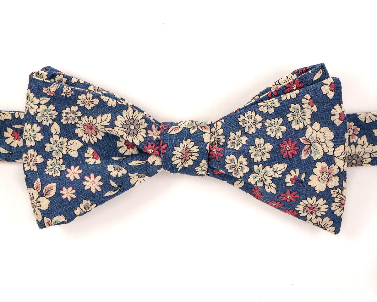 "100% Cotton Blue Floral Pattern Self Tie Bow Tie Classic Butterfly Shape Adjustable from 14.5""-18"" Handmade in Seattle, WA Didn't find the right color or size? Special event, party, school formal or wedding that needs a bespoke bow tie?   We'd love to custom make your perfect bow tie. Shoot us an email and we'll work with you to find the right fit."