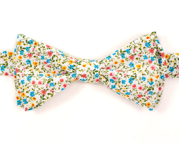 "100% Cotton White w/ Colorful Floral Print Self Tie Bow Tie Classic Butterfly Shape Adjustable from 14.5""-18"" Handmade in Seattle, WA Didn't find the right color or size? Special event, party, school formal or wedding that needs a bespoke bow tie?   We'd love to custom make your perfect bow tie. Shoot us an email and we'll work with you to find the right fit."
