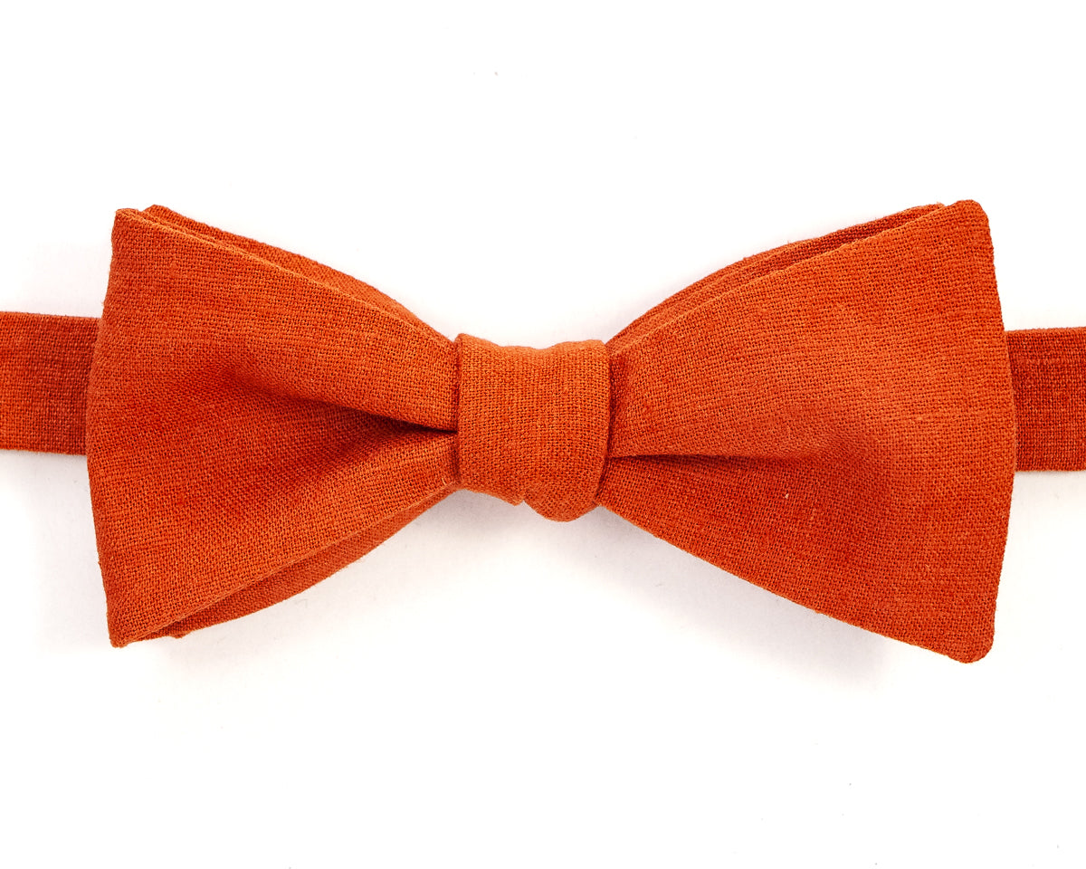 "100% Linen Burnt Orange Self Tie Bow Tie Classic Butterfly Shape Adjustable from 14.5""-18"" Handmade in Seattle, WA Didn't find the right color or size? Special event, party, school formal or wedding that needs a bespoke bow tie?   We'd love to custom make your perfect bow tie. Shoot us an email and we'll work with you to find the right fit."