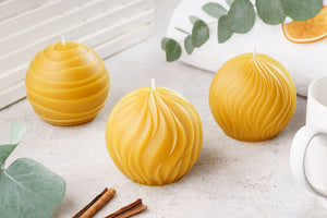 three pure beeswax round candles