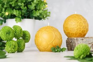 two pure beeswax decorative candles