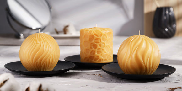 three decorative pure beeswax candles