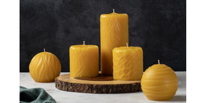 various pure beeswax pillars and round candles