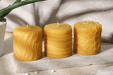 three pure beeswax pillars in the sun