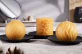 three pure beeswax candles