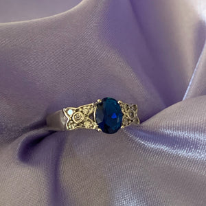 Silver and blue oval ring