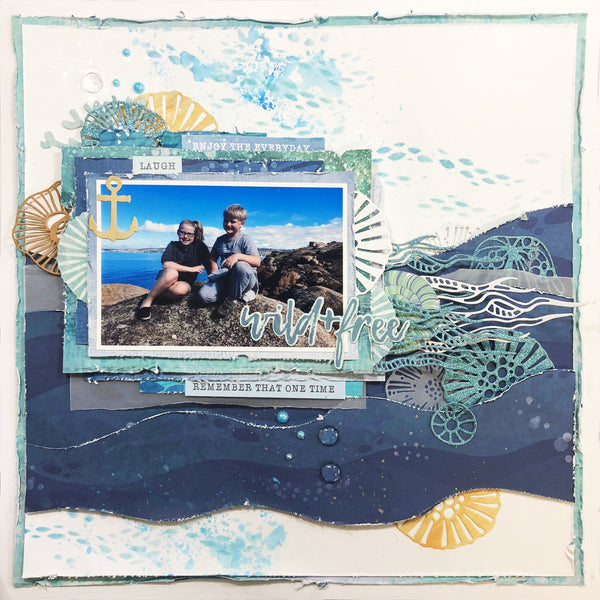 two kids sitting on a rock on vacation at the beach scrapbooking layout