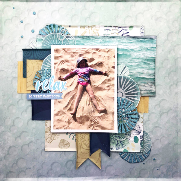 travel scrapbooking layout with a girl laying on the beach