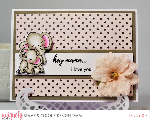 A mummy elephant and a baby elephant hugging on a hand made card