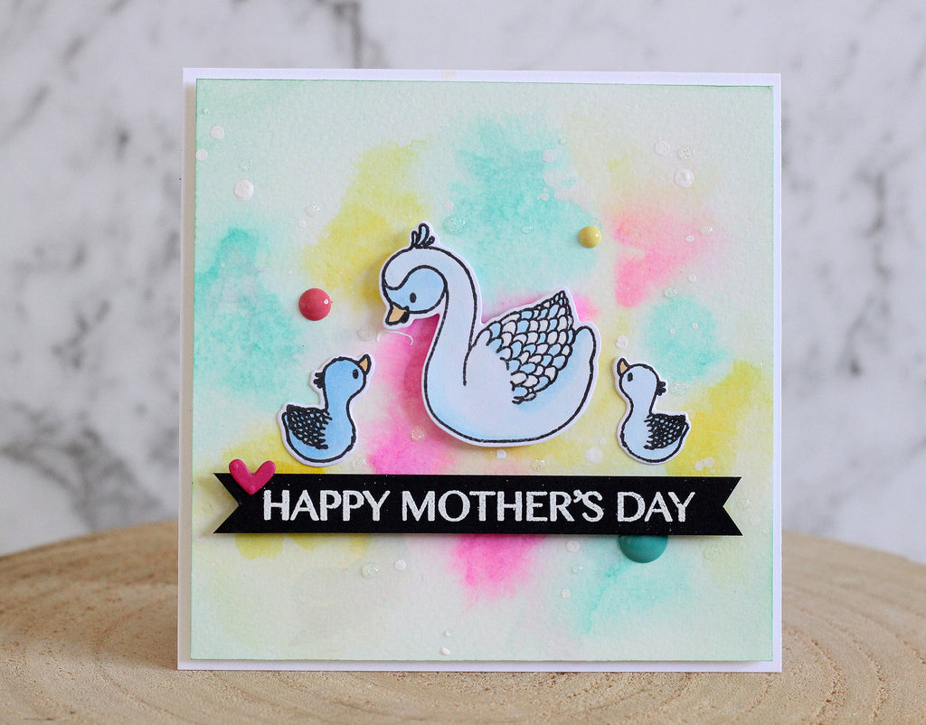 Handmade Mothers Day card with a mummy swan and baby swans