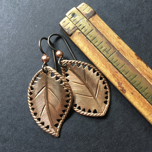 Warm brass yin / yang leaf earrings