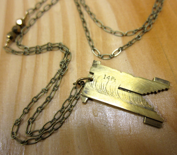 Vintage brass linotype necklace with various letters