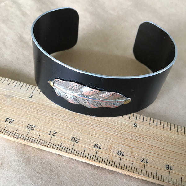 Simple silver feather aluminum cuff.