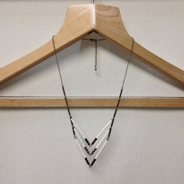 Angles & Bones Necklace; brass breast plate