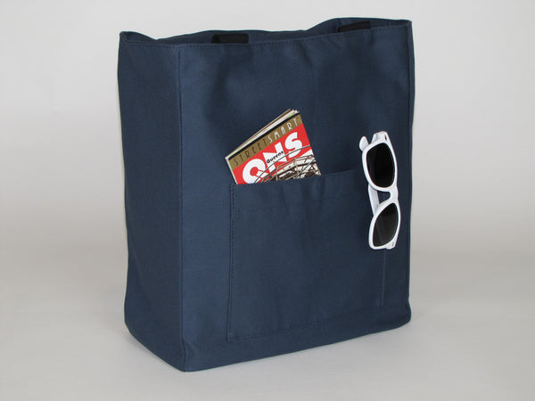 Blue canvas tote bag with pockets