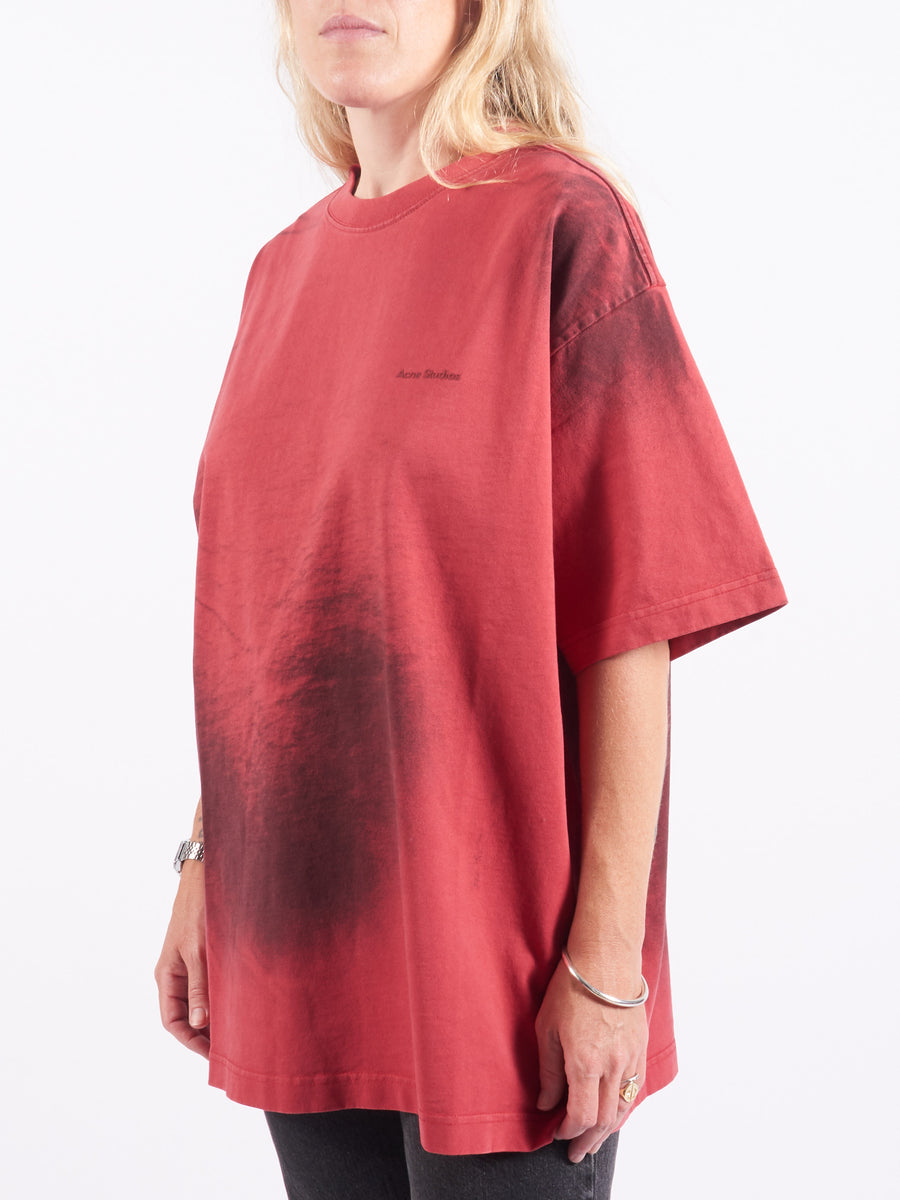 Acne-Studios-Red-Rubber-Spray-Paint-T-Shirt-On-Body