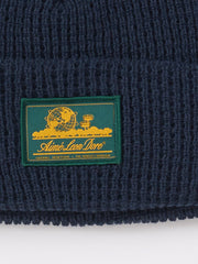 Aimé-Leon-Dore-Flag-Navy-Waffle-Knit-Beanie-on-body