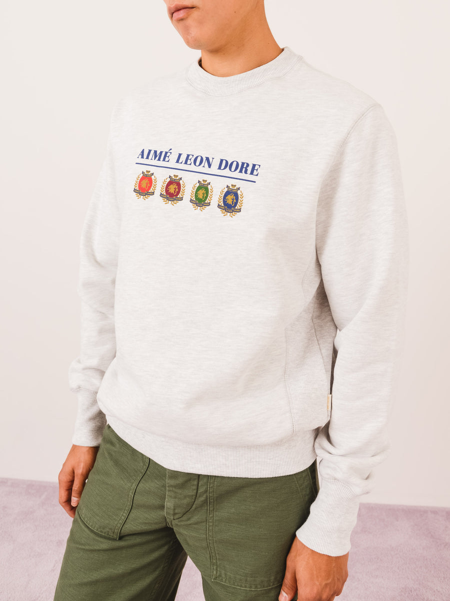 Aimé-Leon-Dore-Grey-Crest-&-Logo-Crewneck-Sweatshirt-on-body