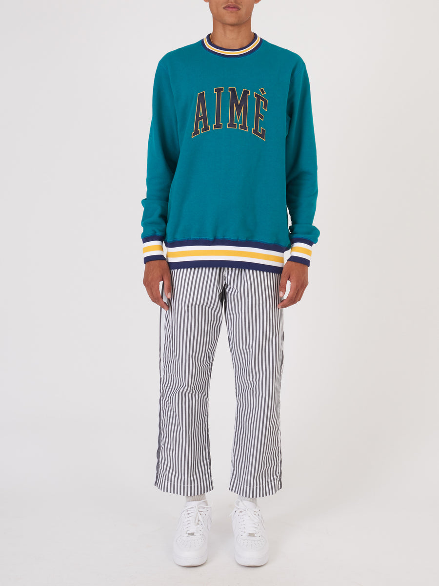 Aimé-Leon-Dore-Mariner-Green-Terry-Collegiate-Crewneck-on-body