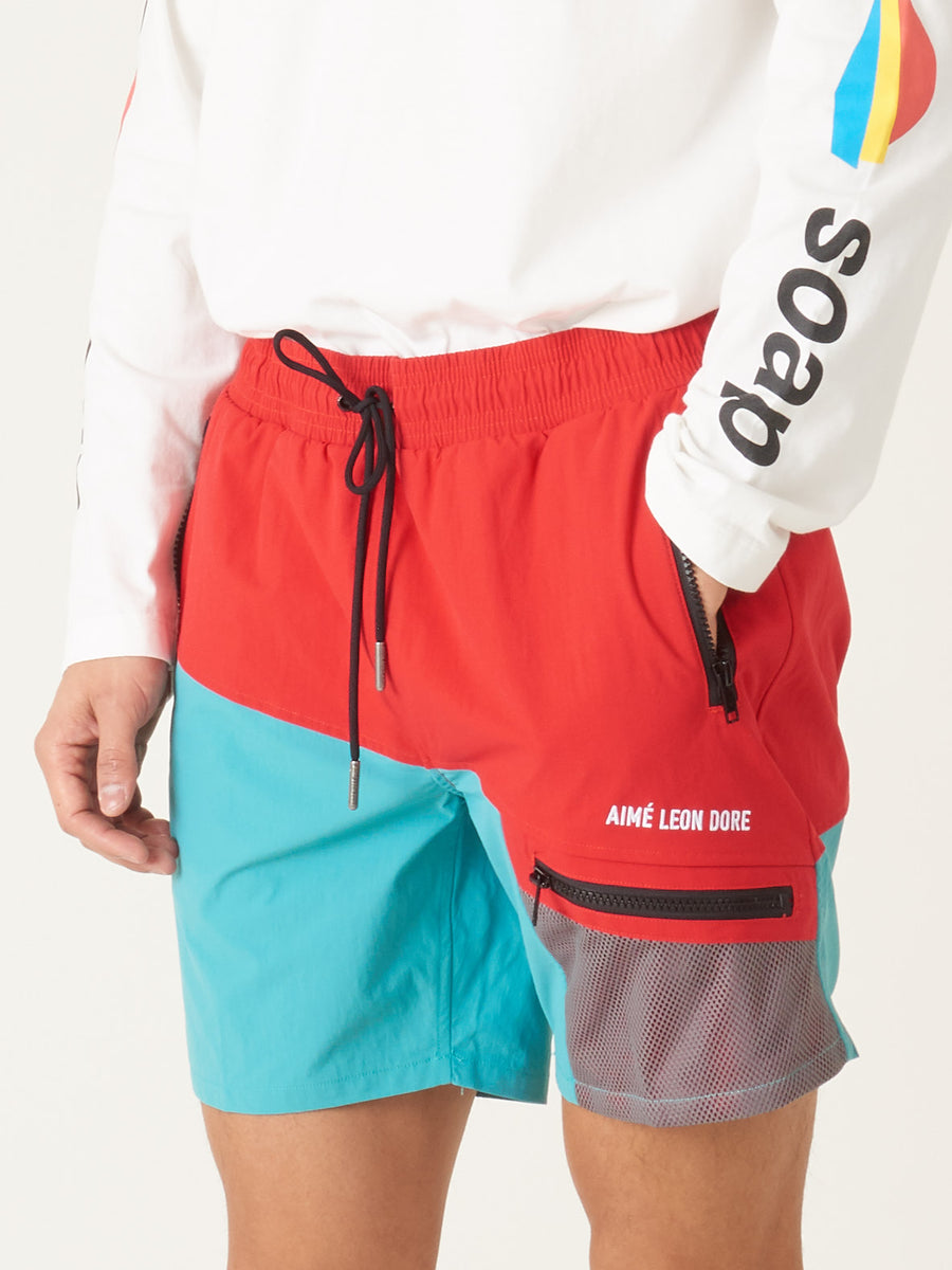 Aimé-Leon-Dore-Mineral-Red/Tropical-Green-Zipper-Pocket-Shorts-on-body