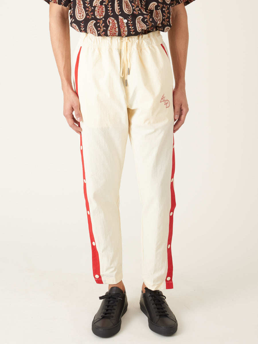 Aimé-Leon-Dore-Sail/Mineral-Red-Warm-up-Track-Pants-on-body