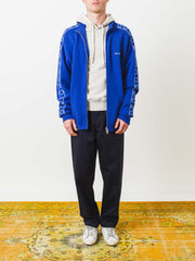 etudes-blue-time-out-jersey-track-jacket-on-body