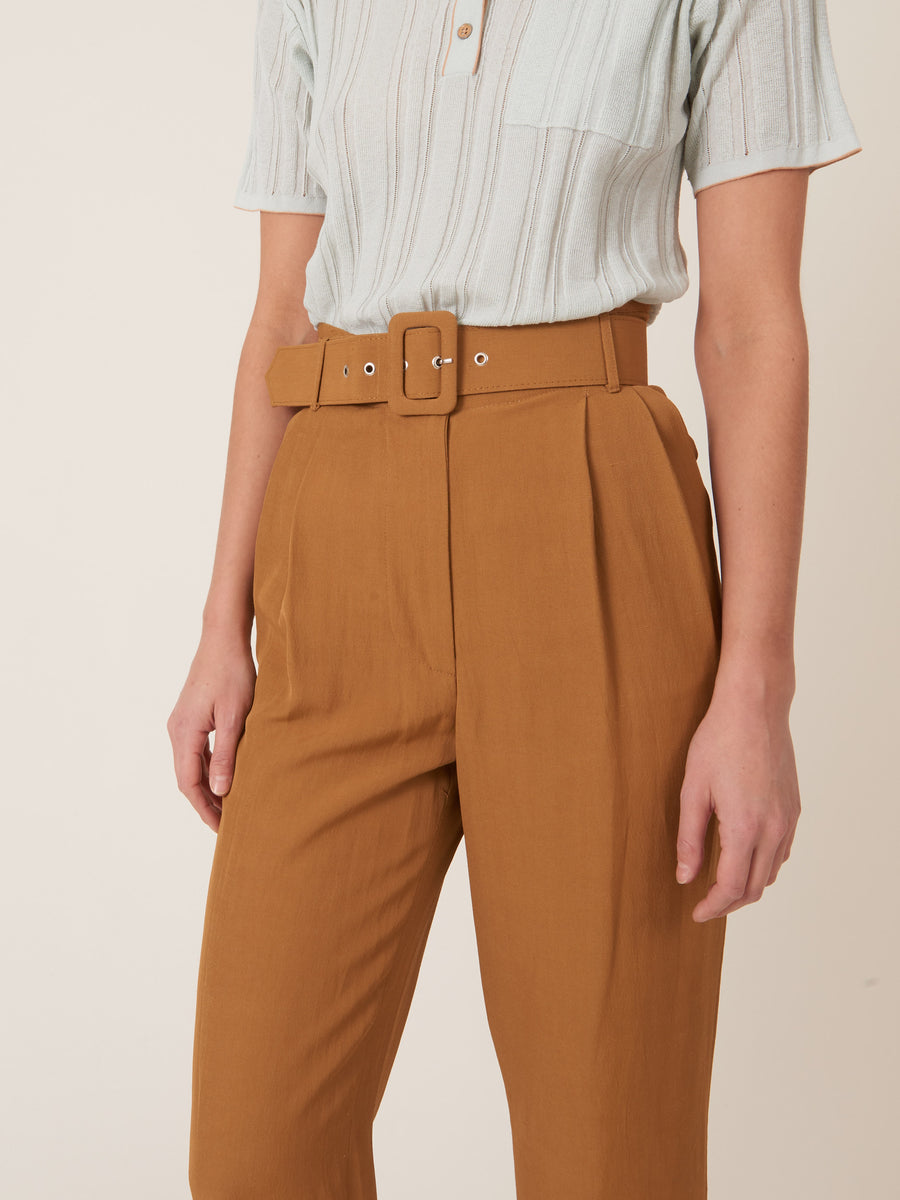 isa-arfen-Dulce-De-Leche-High-Waisted-Belted-Trousers-on-body