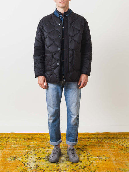 our-legacy-quilted-parachute-jacket-black-on-body
